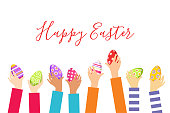 Children hands with Easter eggs isolated on a white background