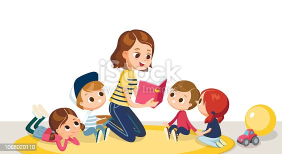 Children in a kinder garden. Children listening to the teacher. Teacher reading book to children.