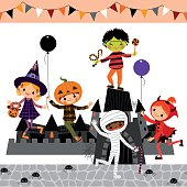 Multicultural Children on the playground with Halloween Castle. RGB, EPS 10.