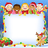 Multi-ethnic group of children and Christmas reindeer with copy space poster.