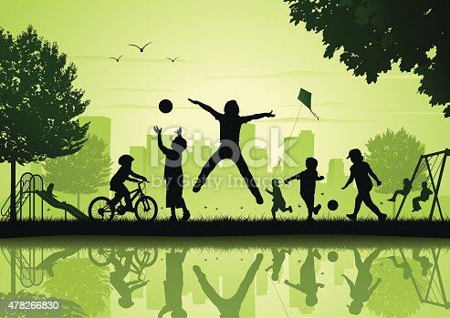 Silhouette of children playing in the city park