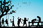 Children black silhouettes playing outdoor