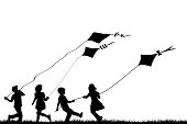 Children silhouettes playing with kites