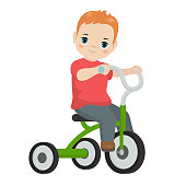 Little boy riding on the tricycle. Cartoon style illustration.