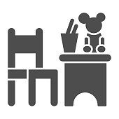 istock Children table and chair with toys solid icon, interior concept, children room sign on white background, table and chair with toy and stand for pencils icon in glyph style. Vector graphics. 1282414022