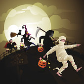 A Halloween vector illustration. Happy children dressed in Halloween costumes carried bags full of candies. Very high resolution jpeg file size included: 4500 x 4500 pixels or 22.5 x 22.5 inches.