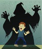 Image of a boy frozen in fright when confronted by monster shadowy figure.