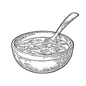 Chili con carne in bowl with spoon - mexican traditional food.