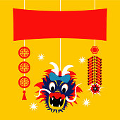 Red banner decoration with dangling coins, fire crackers and dragon heads