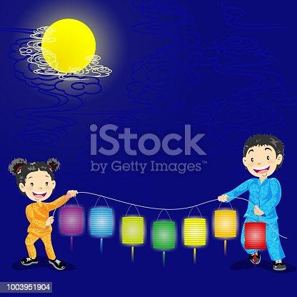 istock Chinese Children Holding Colorful Lantern 1003951904