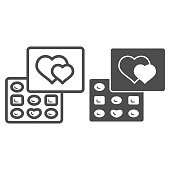 Chocolates in a box line and solid icon, Chocolate festival concept, chocolates in heart shaped box sign on white background, Valentine day dessert icon in outline style. Vector graphics