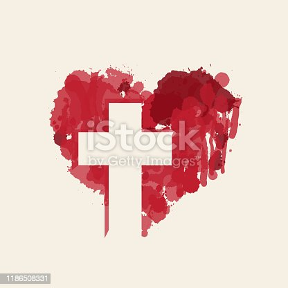 istock christian cross in the abstract red heart inside 1186508331