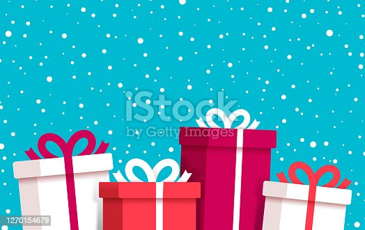 istock Christmas and Holiday Gifts Snow Winter Background 1270154679