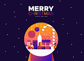 Merry Christmas and Happy New Year greeting card illustration of colorful city inside snow globe in modern gradient style.