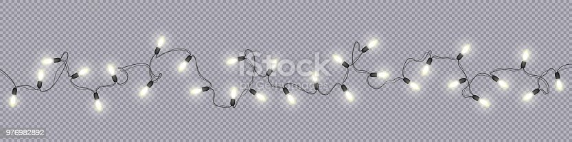 Glowing light bulbs Christmas and New Year realistic garlands isolated on transparent background Xmas decorations for festive design of postcards, banners, posters, websites Vector design elements
