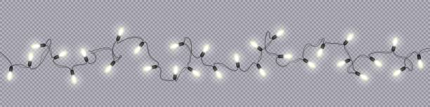 christmas and new year garlands with glowing light bulbs - oświetlenie bożonarodzeniowe stock illustrations