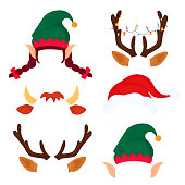 Christmas antlers with light garland, elf hat and ears, bull horns. Funny masks.