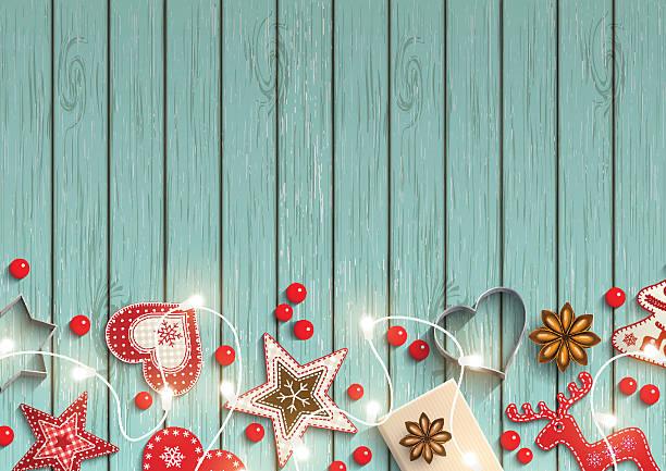 christmas background, small scandinavian styled decorations lying on blue wooden - retroküchen stock-grafiken, -clipart, -cartoons und -symbole