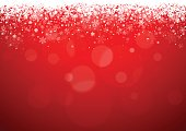 Red Christmas background with snowflakes and patches of light