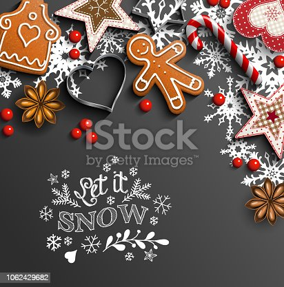 Christmas background, gingerbread cookies, ornaments, candy canes and anise stars laying on black background, with text Let it snow, vector illustration, eps 10 with transparency