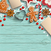 Christmas background with gingerbread cookies, spices and traditional ornaments on blue wooden background, inspired by flat lay style, vector illustration, eps 10 with transparency and gradient mesh