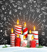 Christmas background with group of burning red and white candles on black background with chalk doodles, vector illustration, eps 10 with transparency