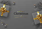 Christmas background. Xmas design realistic gift boxes with golden lush bow, pine branches, fir spruce branch, decorative balls. 3d dark gray snowflake. Flat lay, top view. New year's composition