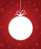 Christmas ball on red background with snowflakes.