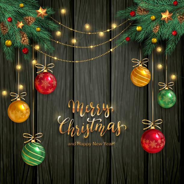 stockillustraties, clipart, cartoons en iconen met kerstballen en fir tree takken op donkere houten achtergrond - kerstbal