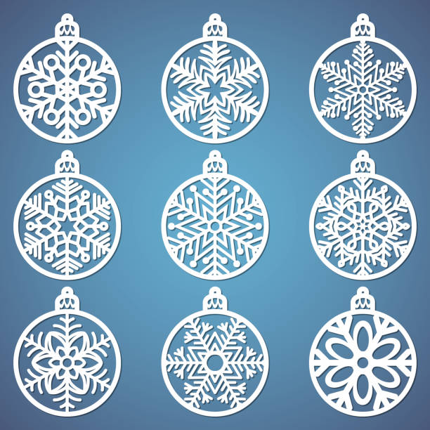Christmas balls set with a snowflake cut out of paper. Templates for laser cutting, plotter cutting or printing. Festive background. Christmas balls set with a snowflake cut out of paper. Templates for laser cutting, plotter cutting or printing. Festive background. decorative laser cut set stock illustrations