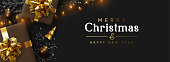 Christmas banner. Background Xmas design of sparkling lights garland, brown realistic gifts box, black snowflake and glitter gold confetti. Horizontal christmas poster, greeting card, headers, website