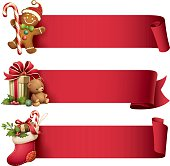 illustration of gingerbread man, christmas stocking and gift with teddy bear with ribbon banner