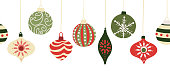 istock Christmas baubles seamless vector border. Repeating banner background with hanging Christmas ornament garland red and green. Use for holiday greeting card decor, letterhead, banners, fabric trim 1272389581