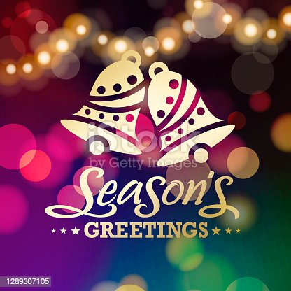 Celebrate Christmas with gold colored Christmas bells symbol and sparkling decorations on the colorful lights background