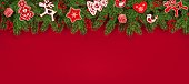 Christmas border of realistic fir branches, holly berries, Scandinavian toys