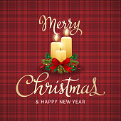 Christmas sparkle candles light up the background of tartan cloth pattern