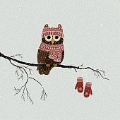Christmas card with a branch with cute owl in winter