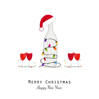 Christmas champagne bottle with colorful light bulb  and santa claus hat. Wine glass and cocktail party. New year night