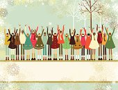 Christmas card with a happy multiethnic group of children standing on a banner. Copy space.