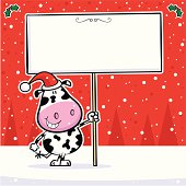 A cool christmas cow with sign.