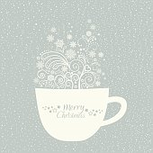 Greeting card with Christmas cup with design elements on blue background