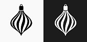 Christmas Decoration Icon on Black and White Vector Backgrounds. This vector illustration includes two variations of the icon one in black on a light background on the left and another version in white on a dark background positioned on the right. The vector icon is simple yet elegant and can be used in a variety of ways including website or mobile application icon. This royalty free image is 100% vector based and all design elements can be scaled to any size.
