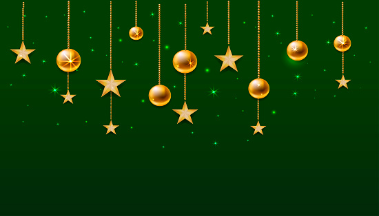 Christmas decorations. Golden balls and stars hang on a string. Sparks shine all around.