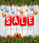 Vector Illustration of Christmas Decorations wirh Red Sale Badges on white wood background