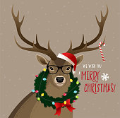 Christmas deer wearing glasses and sweater.