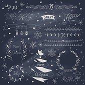 Christmas design elements set on blackboard