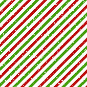 Christmas diagonal striped red and green lines on white background with snow texture, Vector
