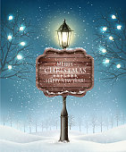 Christmas evening winter landscape with lampposts. Vector