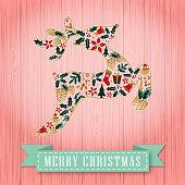 Christmas floral form a reindeer shape, pink color vintage wooden background and