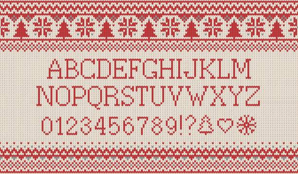 christmas font. knitted latin alphabet on seamless knitted pattern with snowflakes and fir. nordic fair isle knitting, winter holiday sweater design. vector illustration. - winter fashion stock illustrations, clip art, cartoons, & icons